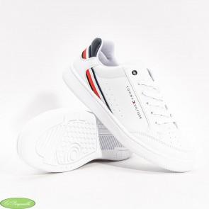 Zapatillas Tommy Hilfiguer en color blanco de piel.